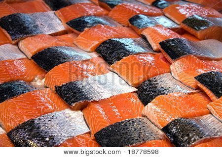 Salmon fillets for sale at a fish market displayed with a patchwork effect