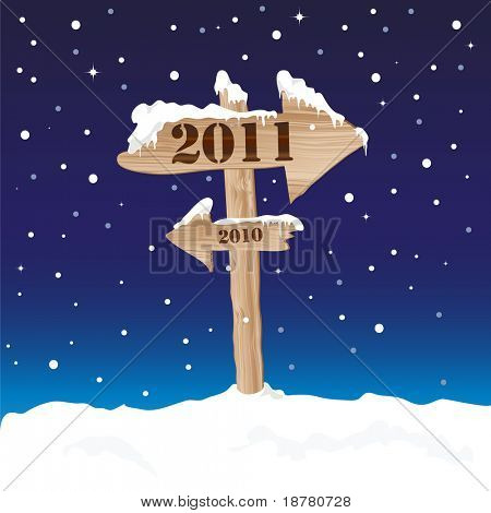 A wooden sign showing the way to 2011 from 2010. New Year's eve concept. Also available in vector format.