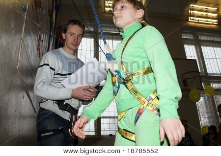 """RUSSIA, MOSCOW - DEC 12: Participants of competitions prepare for performance """"City youthful competitions on climbing sport Winter 2010"""" December 12, 2010 in Moscow, Russia"""