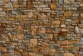 foto of wall-stone  - Colorful old stone wall texture - JPG