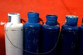 Metal Cooking Gas Tanks Blue And White Orange Background poster