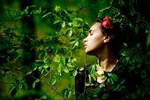 Woman With Flower In Hair In Green Tree Leaves poster