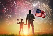 Patriotic holiday. Happy kid, cute little child girl and her father with American flag. USA celebrat poster
