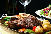 stock photo of beef shank  - delicious beef shank served on a sizzling iron plate - JPG