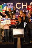Senator Barack Obama campaigning for president, lifting hand and supporters rallying