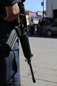 Closeup of M4 carbine / assault rifle held by a special forces soldier on the Mexican side of the US