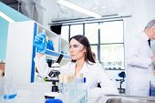 Laboratory, Biotechnology, Experiment. Young Brunette Cute Intern Is Studying New Technology In Scie poster