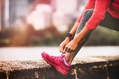 Runner woman getting ready to run tying running shoes laces. Healthy lifestyle jogging motivation cl poster