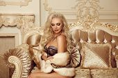 Beautiful Alluring Blond Woman In Fur Coat Sitting On Royal Sofa In Luxury Modern Interior. Beauty G poster