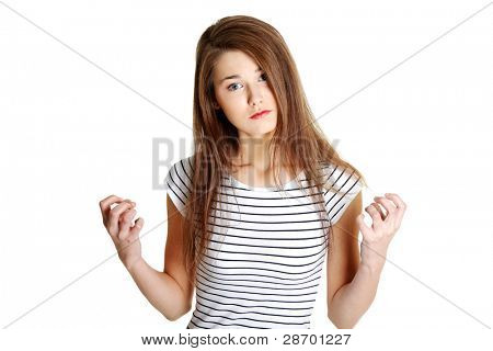 Portrait of a young angry caucasian female teen, on white.