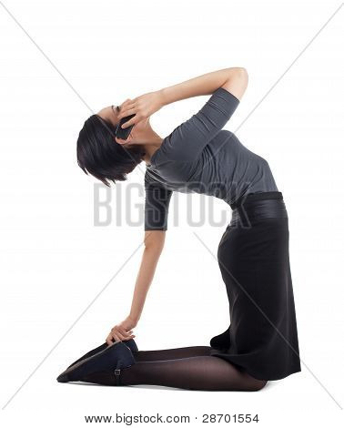 businesswoman in yoga pose with cell phone