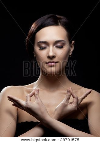 young woman relax with yoga sign in dark