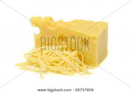Chunk Of Cheese And Pile Of Grated Cheese