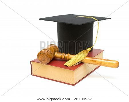 Cap Graduate, Gavel And Book On A White Background