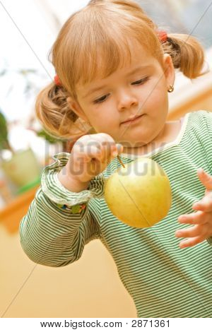 Girl Playing With Apple