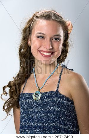 Portrait Of A Smiling Pretty Young Girl With Long Ringlets Hair