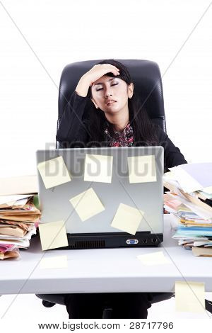 Frustrated Businesswoman With Her Tasks