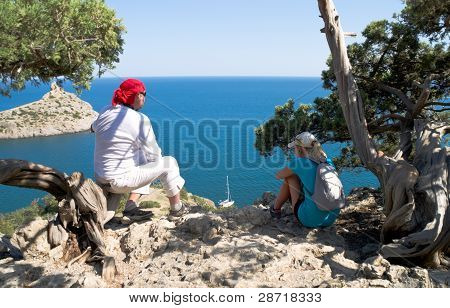 Two Travelers From The Cliff Admiring The Sea