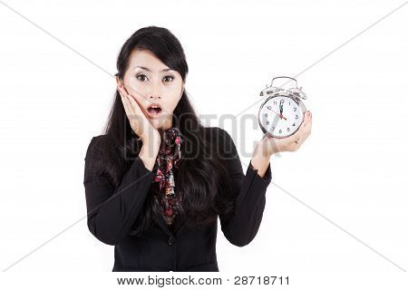 Shocked Businesswoman Holding Alarm Clock