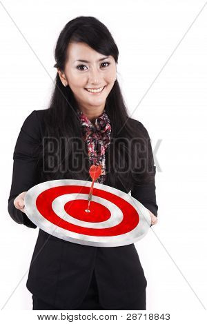 Smiling Businesswoman With Dartboard