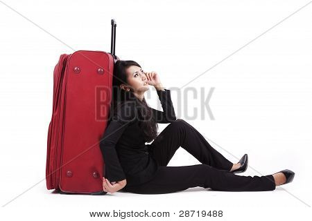 Businesswoman Sitting With Lugage