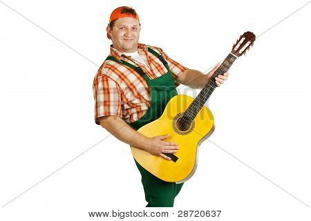 Work In Overall Plays Guitar