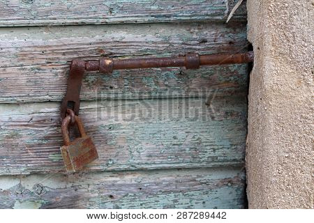 Rusted Metal Latch Mounted On
