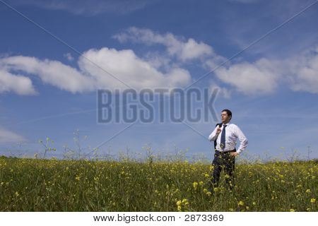 Businessman Enjoying A Hot Summer Day