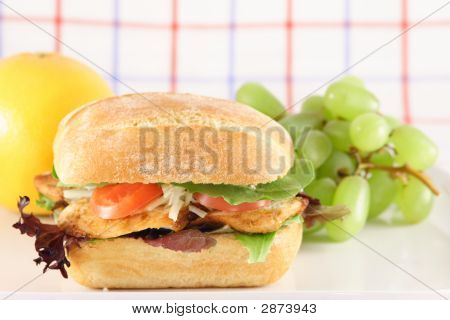 Grilled Chicken Sandwich And Fruits