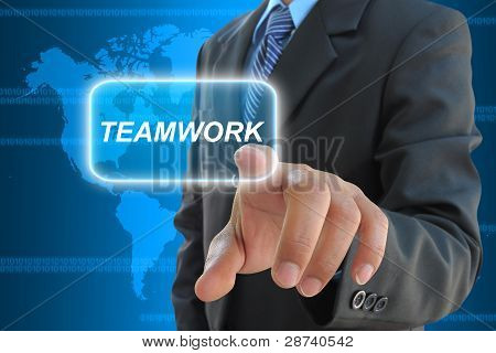 businessman hand pushing teamwork button on a touch screen interface
