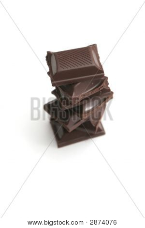 It Is A Lot Of Segments Of Chocolate On A White Background