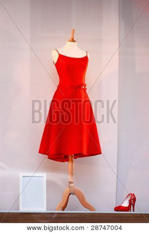 Red Dress And Red Shoes In A Shop Window