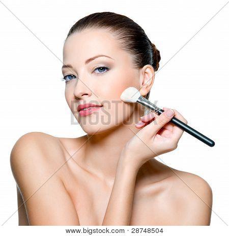 Beautiful Woman Applying  Rough On Cheek