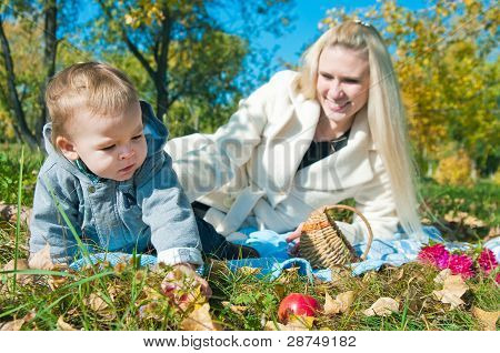 The Young Woman With The Son On Walk