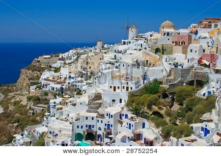 Traditional Windmills In Village Oia In Santorini, Greece