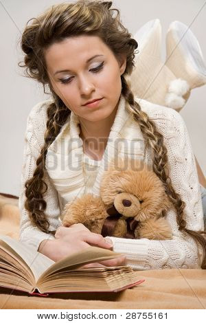 Girl With Books And Toy