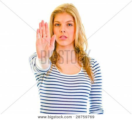 Portrait Of Serious Teen Girl Showing Stop Gesture