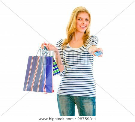 Portrait Of Beautiful Teen Girl With Shopping Bags Giving Credit Card