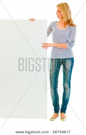 Full Length Portrait Of Teen Girl Holding Blank Billboard