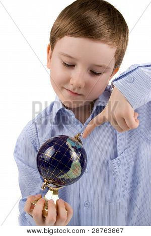 Boy Points A Finger At The Globe