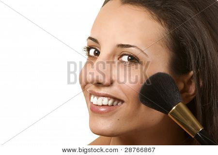 Young Woman Applying Blusher
