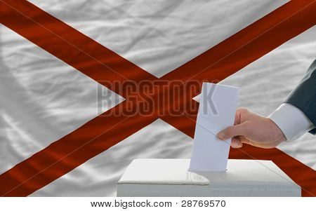 Man Voting On Elections In Front Of Flag Us State Flag Of Alabama