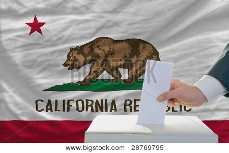 Man Voting On Elections In Front Of Flag Us State Flag Of California