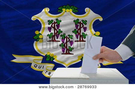 Man Voting On Elections In Front Of Flag Us State Flag Of Connecticut