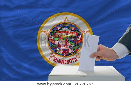Man Voting On Elections In Front Of Flag Us State Flag Of Minnesota