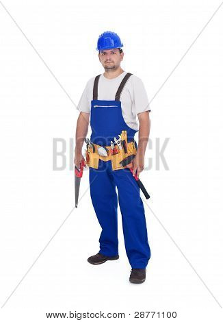 Handyman Or Construction Worker Standing With Lots Of Tools