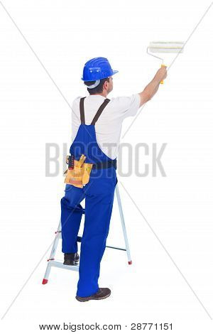 Handyman Or Worker Painting With Roller Brush Leaning On Ladder