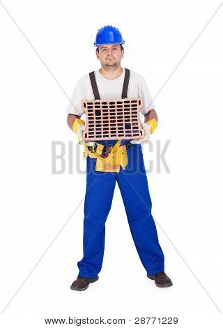 Handyman Or Worker Holding Brick