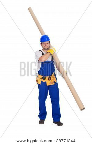 Handyman Or Worker Carrying Pipe