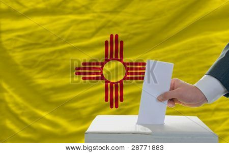 Man Voting On Elections In Front Of Flag Us State Flag Of New Mexico